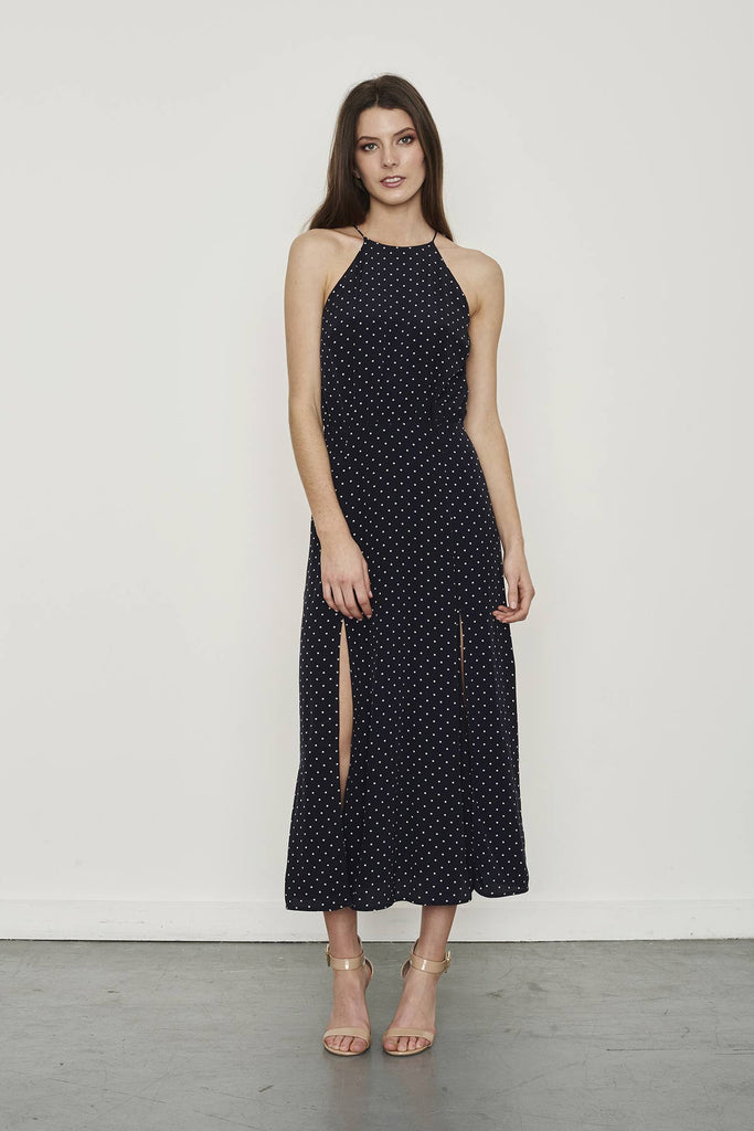 Model wearing Zimmermann Navy polka dot dress