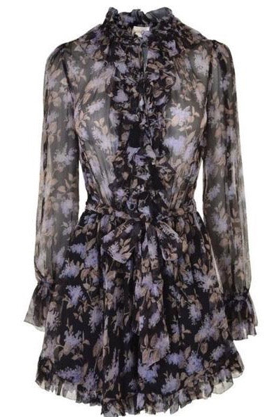 Zimmermann Stranded ruffle playsuit. Silk playsuit with black and lilac floral print.