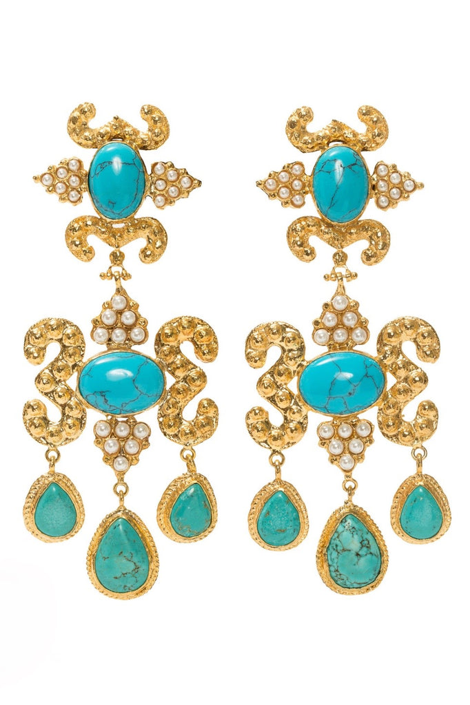 product shot of gold statement earrings with turquoise stones and pearls.