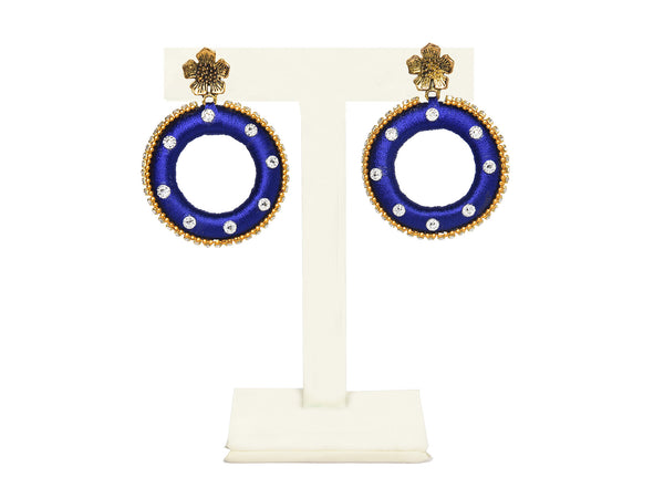 A pair of earrings in royal blue, with a gold flower top IP/GJ/E-011