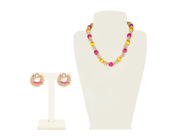 A half set in pink, yellow and clusters of pearl beads IP/GJ/S-014