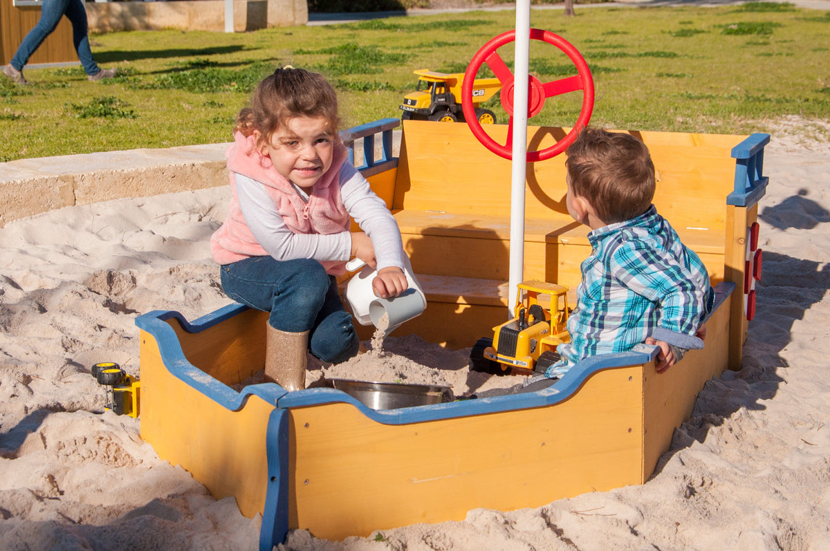 Boat Shaped Sandpit with kids playing