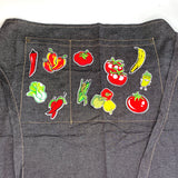 Healthy Vegetables And Fruit Patch Set Op een zwarte keuken schort