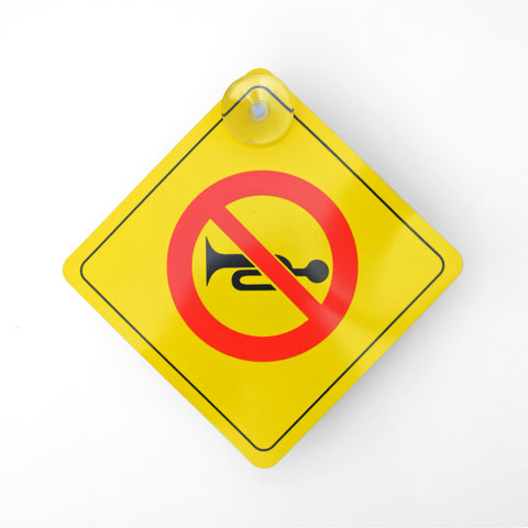 Front of No Honking Car Sign