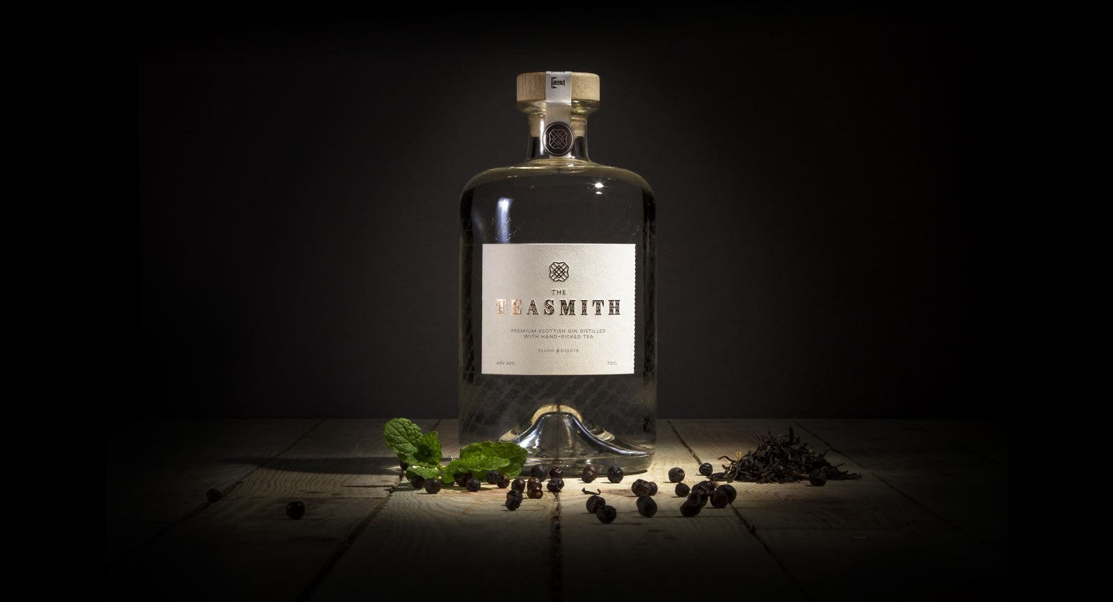 The Teasmith Scottish Premium gin bottle and botanicals