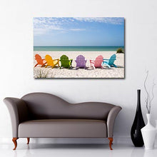 Beach chairs on a beach Art Canvas