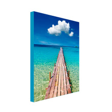 Portrait Art Canvas of long wooden pier heading out to turquoise blue sea with lone white cloud floating above in the centre of a blue sky