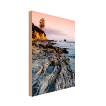 Load image into Gallery viewer, Portrait image of sunset over rock pools at sea with steep cliffs to the peripheral of the image