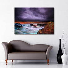 Rough Seas in stormy weather with purple clouds and lightening