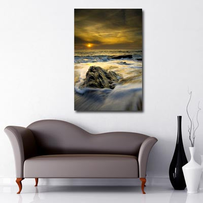 Portrait Art Canvas of cloudy sunset over rough seas with rock in the foreground