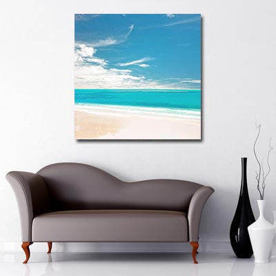 Square Canvas Art of white sand beach with clear turquoise sea and blue sky with intermittent clouds