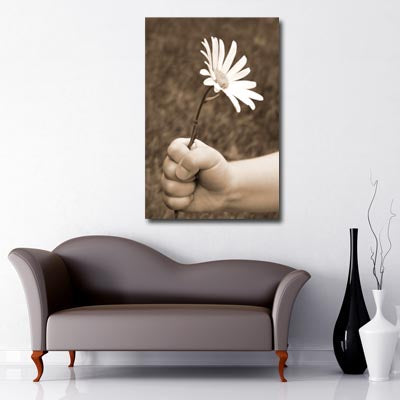 Portrait Art Canvas of childs hand holding white daisy with vintage filter