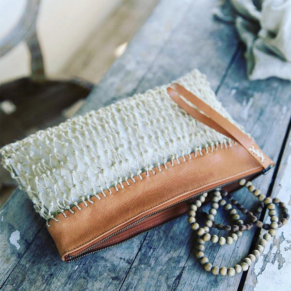 Saba clutch on wooden table