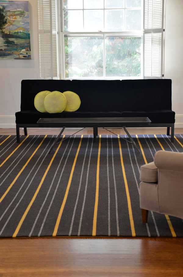 Troy wool rug custom colored with undyed Noir and thin felted marigold