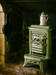 Wood stove with tea pot on top