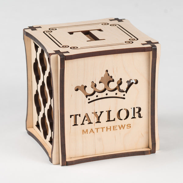 Crowning Classic birth cube made from Maple Hardwood. Front side of cube showing laser cut crown and first name along with etched last name. Finish your nursery in style with personalized nursery décor by Dimensional Décor.