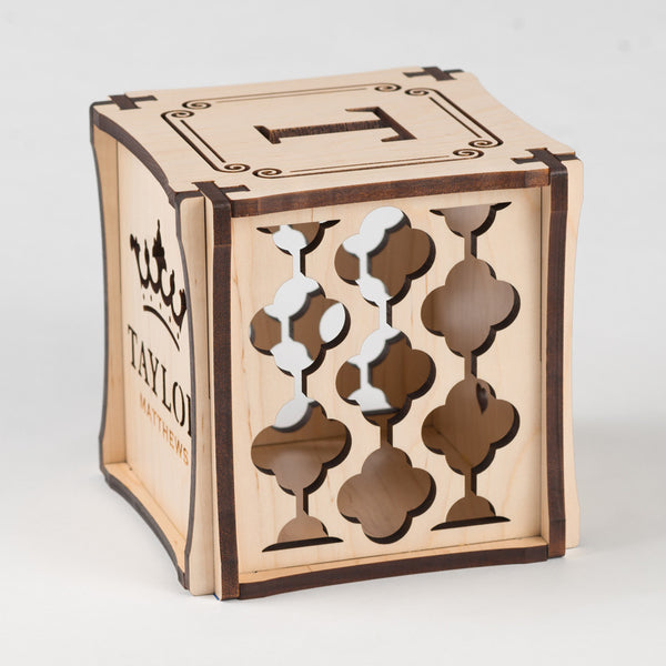 Crowning Classic birth cube made from Maple Hardwood. Right side of cube showing laser cut graphic pattern.