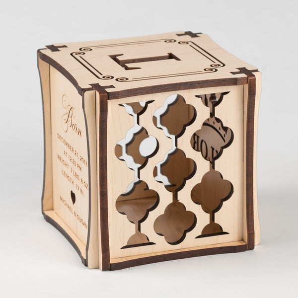Crowning Classic birth cube made from Maple Hardwood. Left side of cube showing laser cut graphic pattern.