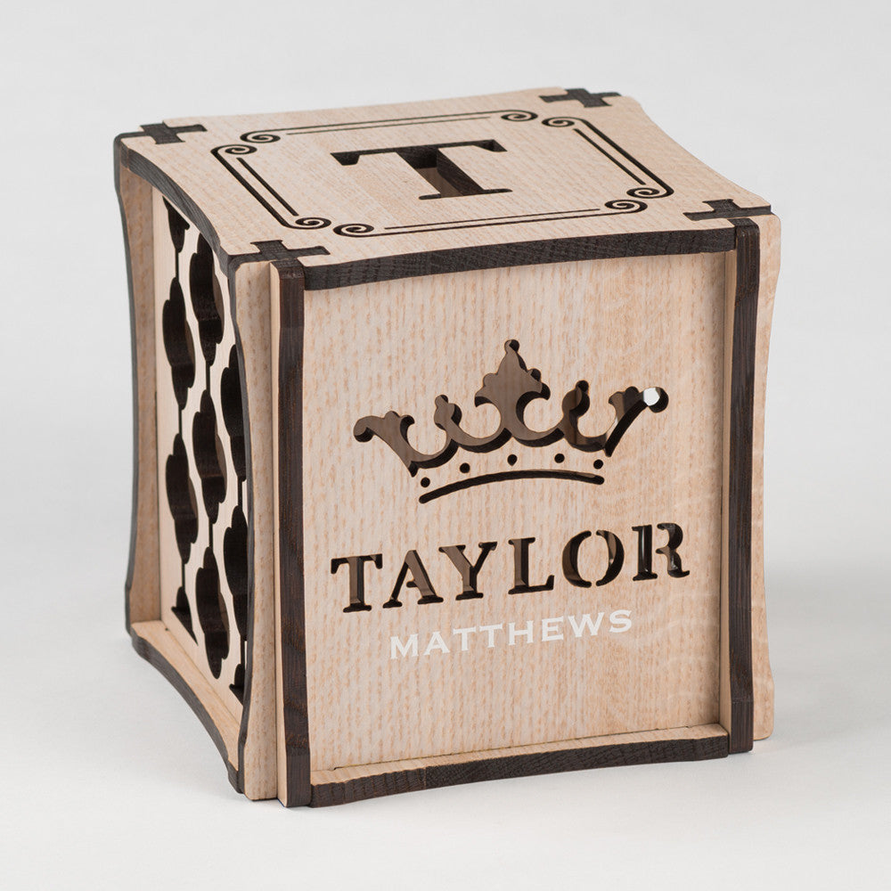 Royal Wash decorative keepsake made from Rift White Oak Hardwood. Front side of cube showing laser cut crown and first name along with printed last name.