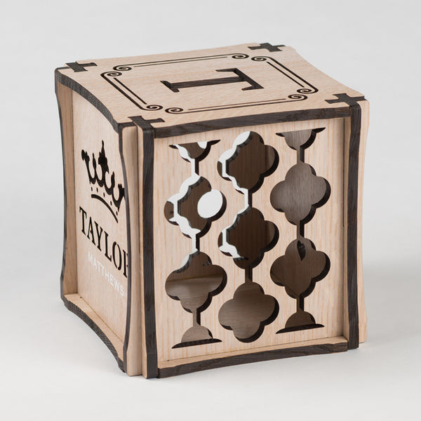 Royal Wash decorative keepsake made from Rift White Oak Hardwood. Right side of cube showing laser cut graphic pattern.