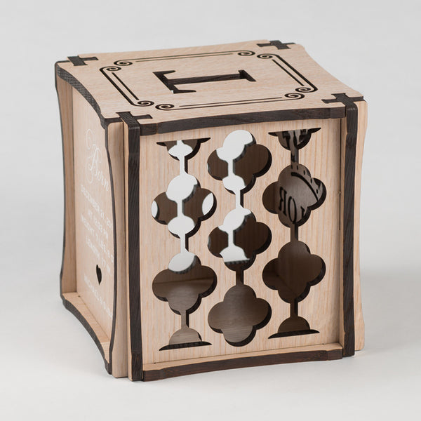 Royal Wash decorative keepsake made from Rift White Oak Hardwood. Left side of cube showing laser cut graphic pattern.