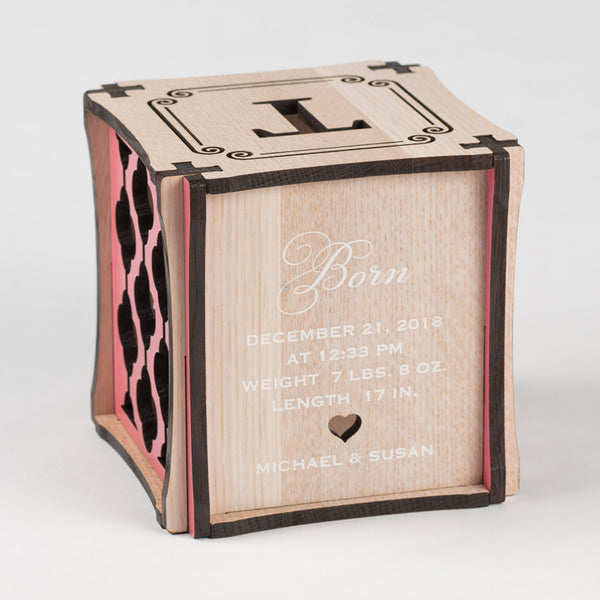 Little Princess birth cube made from Rift White Oak Hardwood with pink stained accents. Backside of cube showing laser cut heart along with printed birth information and parent names.