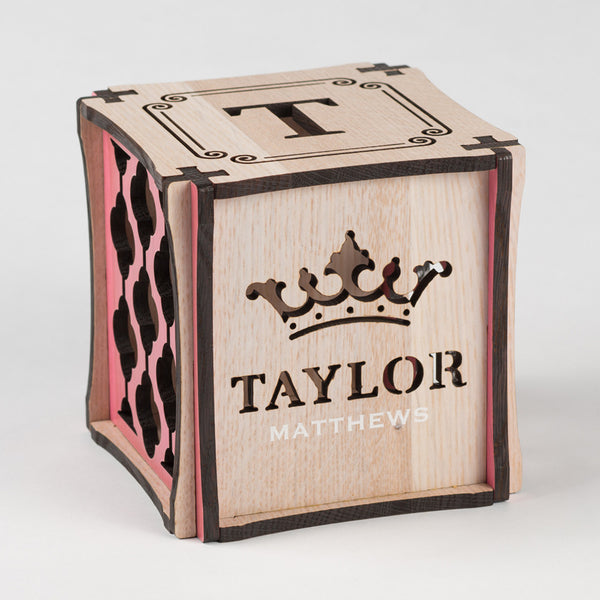 Little Princess birth cube made from Rift White Oak Hardwood with pink stained accents. Front side of cube showing laser cut crown and first name along with printed last name.