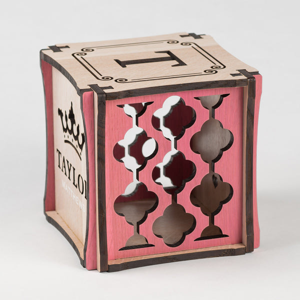 Little Princess birth cube made from Rift White Oak Hardwood with pink stained accents. Right side of cube showing laser cut graphic pattern.