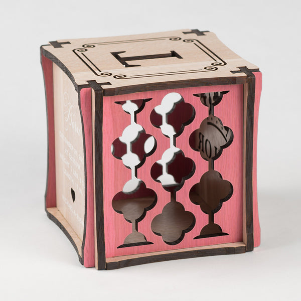 Little Princess birth cube made from Rift White Oak Hardwood with pink stained accents. Left side of cube showing laser cut graphic pattern.