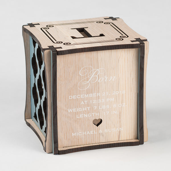 Prince Perfect CUBEMENTO™ birth cube made from Rift White Oak Hardwood with blue stained accents. Backside of cube showing laser cut heart along with printed birth information and parent names.