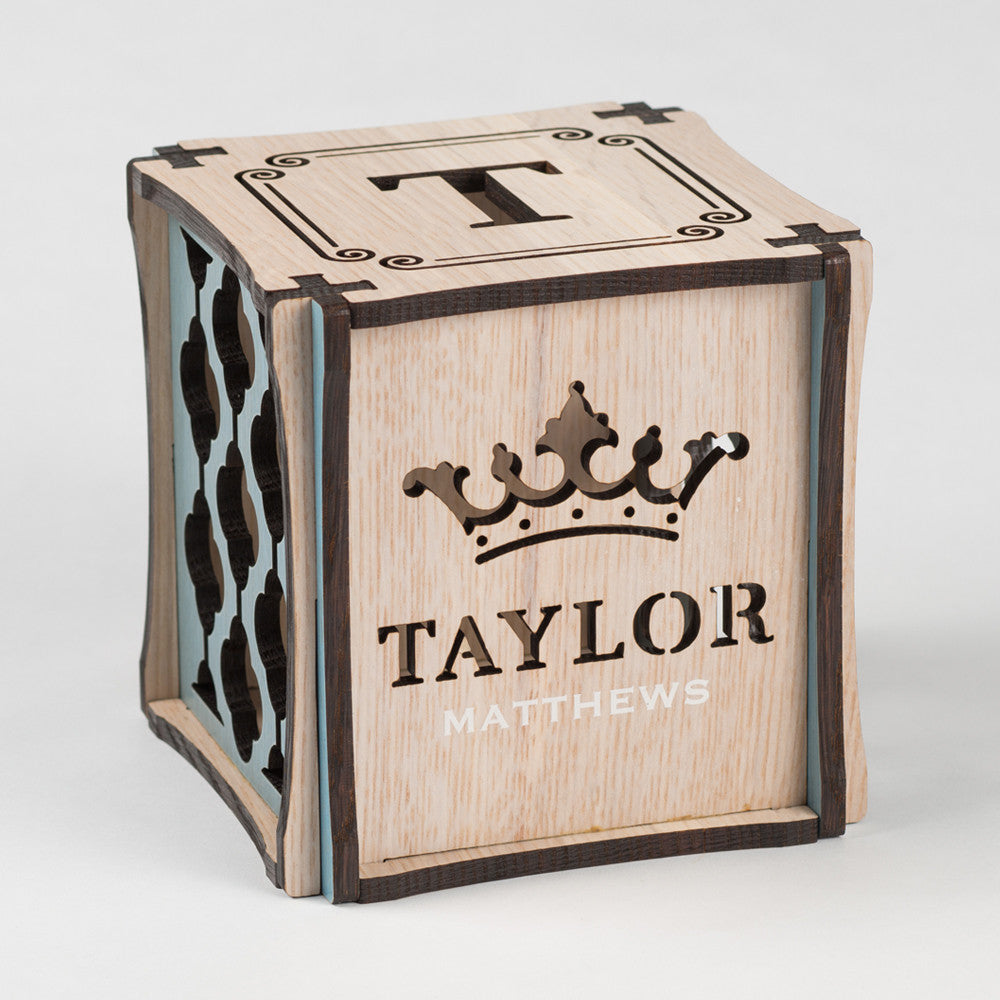 Prince Perfect CUBEMENTO™ birth cube made from Rift White Oak Hardwood with blue stained accents. Front side of cube showing laser cut crown and first name along with printed last name.
