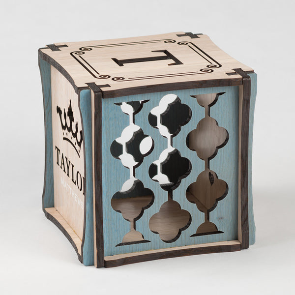 Prince Perfect CUBEMENTO™ birth cube made from Rift White Oak Hardwood with blue stained accents. Right side of cube showing laser cut graphic pattern.