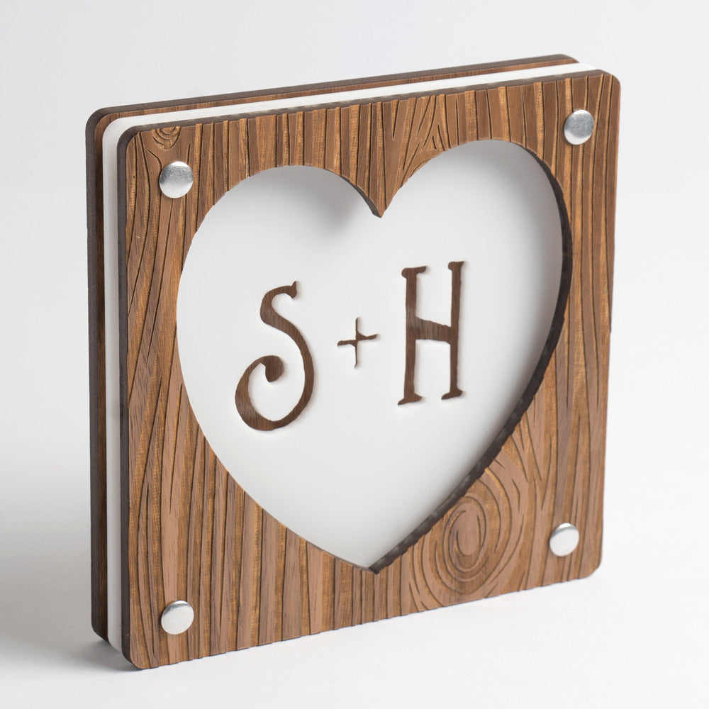 Carved Heart monogram frame made from Walnut MDF and matte white acrylic. Personalized frame features laser cut heart, initials and etched wood grain.