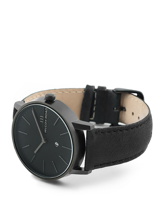 All black men's minimalist affordable watch with genuine black leather band 3/4 view