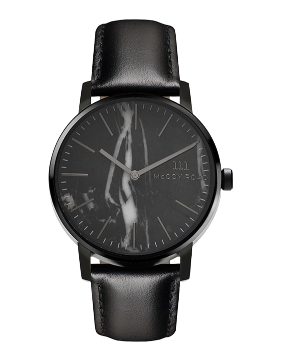 All black with marble face Ten40 watch with black leather band