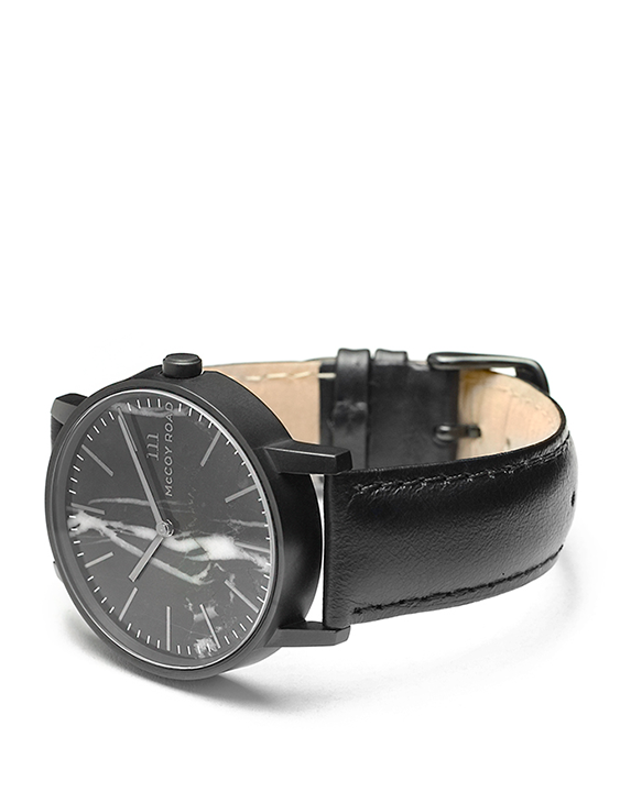 All black with marble face Ten40 watch with black leather band 3/4 view