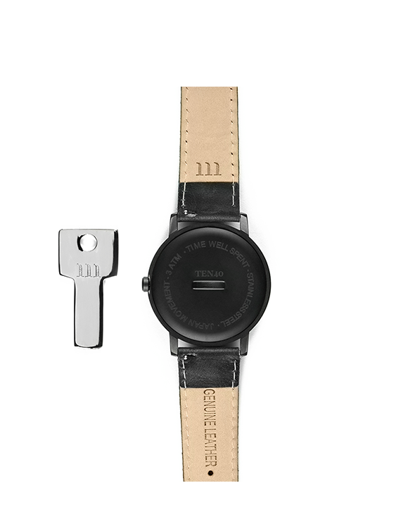 All black with marble face Ten40 watch with black leather band back view