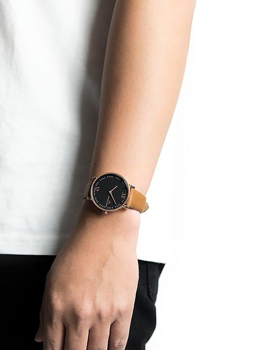 Seven50 Rose Gold and Matte Black McCoy Road Men's Watch With Brown Leather Band on model