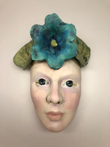 """Wall Face - Teal Flower"""