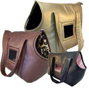 Hand made leather dog carriers pet carriers with style and comfort for your dog.