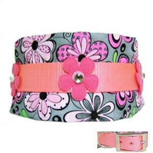 A 3 inch wide dog collar in a mod print fabric with hot pink rhinestone flowers.