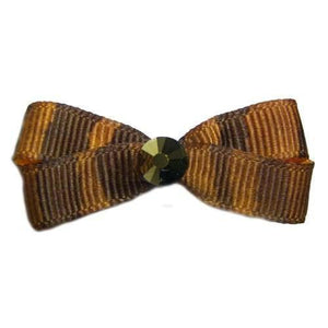 A brown animal prints dog hair bow with a gold crystal in the center for a little bling.