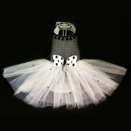 A patterned dog dress with polka dot bow and crystal embellished tutu skirt.