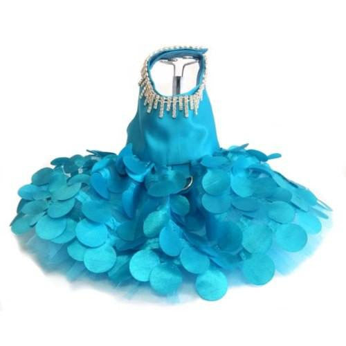 This designer dog dress is in a stylish turquoise with a rhinestone necklace attached.