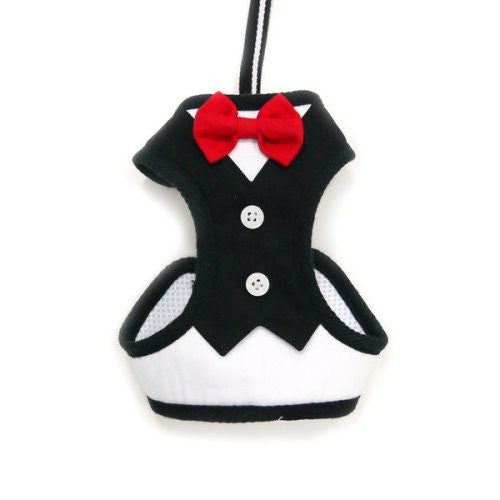 Formal tuxedo dog harness with red bow tie.