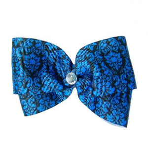 Floral designer dog bow in blue pattern for medium to large dogs.