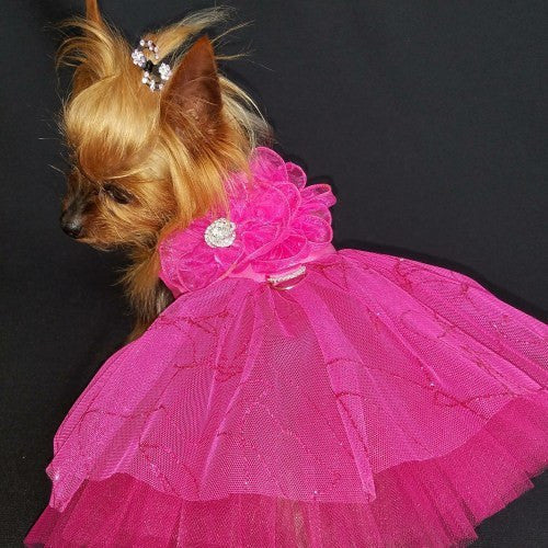 A beautiful fuchsia dog dress that is so sparkly with rhinestone flower and sparkly tulle skirt.