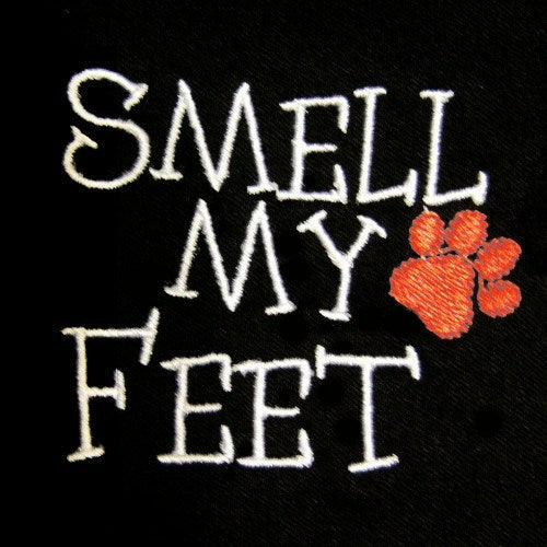 Dog shirt embroidery Smell My Feet close up.