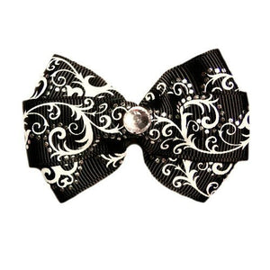 This beautiful dog hair bow has metallic dots and white scrolls. So fancy!