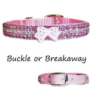 Pastel pink pet collar decorated with rose and lt rose crystals and a cute heart printed bow.
